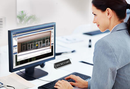 A_woman_using_an_access_control_system_at_a_corporate_office.jpg