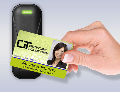Person_waving_an_access_card_in_front_of_a_reader.jpg