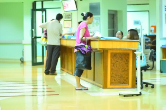 hospital visitor management solutions signing in at a front desk.jpg