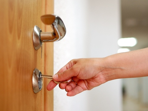 opening a locked door at a school with a key.jpg