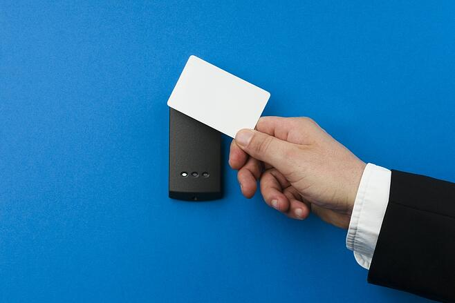 swiping an access card to get in a door.jpg